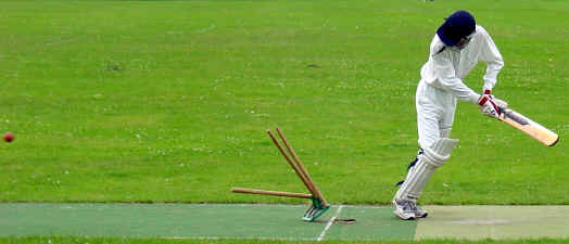 Missed it: Andrew Wardle of Old Fallopians watches the stumps fly after an 008 delivery